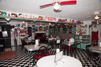 "In the back is Rock-A-Billy Café & Soda Fountain ""Where Country Meets Rock-n-Roll"""